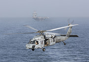 Enterprise Framed Prints - A Mh-60s Knighthawk Conducts A Vertical Framed Print by Gert Kromhout