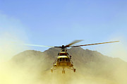 Dust* Posters - A Mi-17 Hip Helicopter Hovers Poster by Stocktrek Images