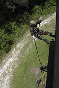 Training Exercise Photos - A Midshipman Rappels Down A Wall by Stocktrek Images