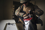 Forensic Art - A Military Policeman Collects Materials by Stocktrek Images