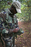 Technical Photo Prints - A Military Technician Uses A Pda Print by Michael Wood