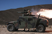 Hmmwv Framed Prints - A Missileman Firing A Bgm-71 Tow Framed Print by Stocktrek Images