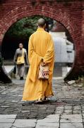 Relaxed Framed Prints - A Monk At The Shaolin Temple In China Framed Print by Justin Guariglia