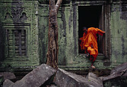 Siem Reap Posters - A Monk Emerges From The Doorway Of An Poster by Steve Raymer
