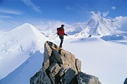 Mountain Climbing Prints - A Mountain Climber Summits Mount Print by Gordon Wiltsie