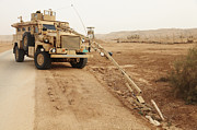 Improvised Explosive Device Framed Prints - A Mrap Vehicle Disassembles An Framed Print by Stocktrek Images