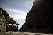 Dirt Roads Photos - A Mrap Vehicle Drives by Stocktrek Images