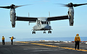 Three People Photo Framed Prints - A Mv-22 Osprey Aircraft Prepares Framed Print by Stocktrek Images