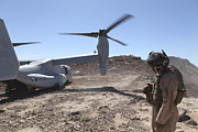 Imperial Valley Prints - A Mv-22 Osprey Tiltrotor Lands Print by Stocktrek Images