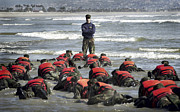 Training Exercise Photos - A Navy Seal Instructor Assists Students by Stocktrek Images