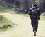 Targets Metal Prints - A Navy Seal Patrols Down The Road Metal Print by Michael Wood