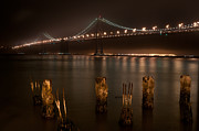 Oakland Photo Originals - A night view of the San Francisco Bay Bridge and Oakland  by Lucas Tatagiba
