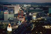 Hotels And Resorts Posters - A Nighttime Aerial View Of The Strip Poster by Maria Stenzel