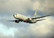 737 Posters - A P-8a Poseidon In Flight Poster by Stocktrek Images