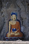 Tibet Framed Prints - A Painted Stone Buddha Near Lhasa Framed Print by Gordon Wiltsie