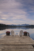 Nautical Structures Photos - A Pair Of Adirondack Chairs On A Dock by Michael Melford