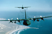 Us Air Force Prints - A Pair Of C-130 Hercules In Flight Print by Stocktrek Images