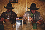 Model Released Photography Photos - A Pair Of Cowboys Enjoy A Cup Of Coffee by Joel Sartore