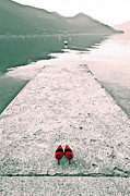 Mountain Lake Posters - A Pair Of Red Womens Shoes Lying On A Walkway That Leads Into A Poster by Joana Kruse