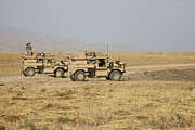 Mrap Photos - A Pair Of U.s. Army Cougar Mrap by Terry Moore