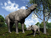 Tree Limbs Posters - A Paraceratherium Mother Grazes Poster by Walter Myers