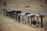 Stop Sign Photo Prints - A Parade Of Mailboxes On The Outskirts Print by Stephen St. John
