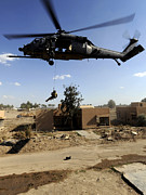 Baghdad Framed Prints - A Pararescueman Rappels From An Hh-60 Framed Print by Stocktrek Images