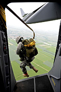 Paratrooper Photo Prints - A Paratrooper Executes An Airborne Jump Print by Stocktrek Images