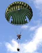 Paratrooper Photo Prints - A Paratrooper Jumps From A Ch-46 Sea Print by Stocktrek Images