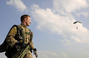 Survival Prints - A Paratrooper Looks On As Other Print by Stocktrek Images