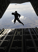 C-130 Prints - A Paratrooper Salutes As He Jumps Print by Stocktrek Images