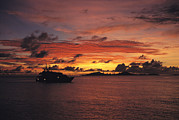 Caroline Islands Prints - A Passenger Boat Silhouetted On Truk Print by Heather Perry
