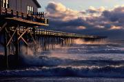 Etc. Photo Framed Prints - A Pier At Nags Head Is Pounded By Early Framed Print by David Alan Harvey