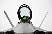 Stealth Prints - A Pilot Checks The Cockpit Of An F-22 Print by Stocktrek Images