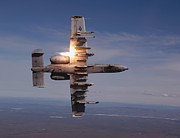 Live Fire Posters - A Pilot Fires A Missile In An A-10 Poster by Stocktrek Images