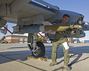 Laser Framed Prints - A Pilot Inspects A Gbu-12 Laser Guided Framed Print by HIGH-G Productions