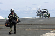 Helicopter Pilot Framed Prints - A Pilot Walks Across The Flight Deck Framed Print by Stocktrek Images
