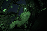 Field Glasses Prints - A Pilot Wears Night Vision Goggles Print by Terry Moore