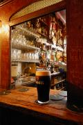 Local Food Framed Prints - A Pint Of Dark Beer Sits In A Pub Framed Print by Jim Richardson