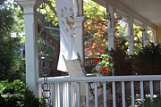 Red Geraniums Prints - A Porch To Reflect Print by Living Color Photography Lorraine Lynch