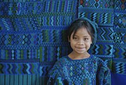 Fabric Framed Prints - A Portrait Of A Guatemalan Girl Framed Print by Raul Touzon