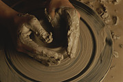 Artists And Artisans Prints - A Potter Makes A Pot From Clay Print by Stephen Alvarez