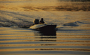 Power Boat Posters - A Power Boater Enjoys A Twilight Poster by Raymond Gehman
