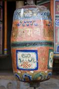 Devotional Art Posters - A Prayer Wheel At A Monastery Poster by David Evans