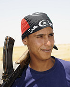 Libyan Framed Prints - A Rebel Fighter With An Ak-47 Assault Framed Print by Andrew Chittock