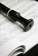 Hobbies Prints - A Recorder Lying On A Book Of Sheet Music Print by Studio Blond
