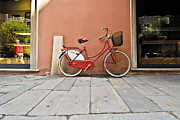 Bologna Photos - A Red Bicycle by Robert Ponzoni