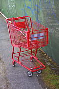 Shopping Cart Prints - A Red Metal Shopping Cart Or Trolley Print by Nathan Griffith