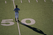 Sports Fields Framed Prints - A Referee On On The 50-yard Line Framed Print by Kenneth Garrett