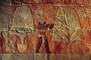 A Relief Of Men Carrying Myrrh Trees Print by Kenneth Garrett